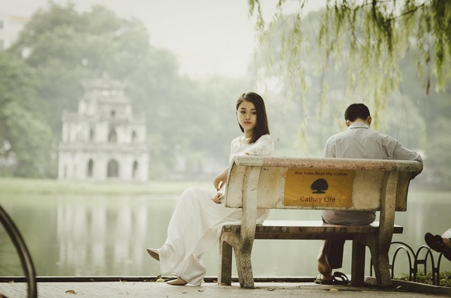 Picture of couple on bench with woman looking away.jpg