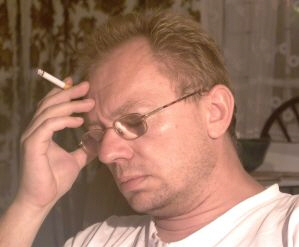 Picture of glum man seated with cigarette.jpg