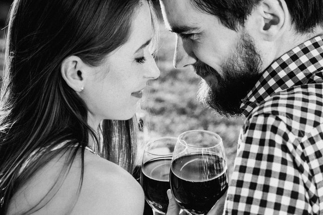 Picture of loving couple holding wineglasses.jpg