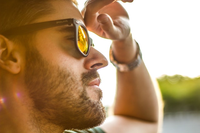 Picture of man in bright sunlight wearing sunglasses.jpg