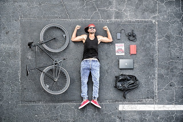 Picture of man posed with bike and daily carry items.jpg