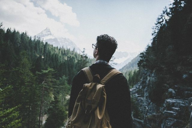 Picture of man with backpack overlooking valley.jpg