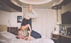 Picture of woman balanced upside down on man on bed.jpg