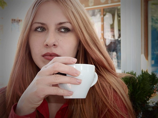 Picture of young woman holding coffee cup.jpg