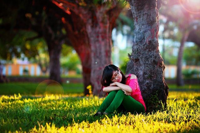 Picture of young woman sitting at base of tree.jpg
